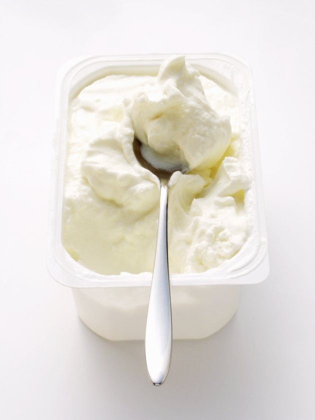 Cottage cheese in white bowl with spoon