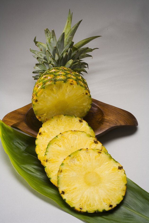Studio shot of a pineapple, cut into slices.