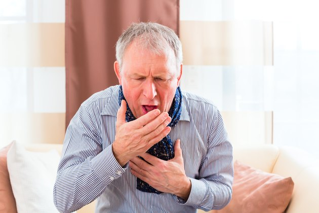 Senior coughing and having the flu