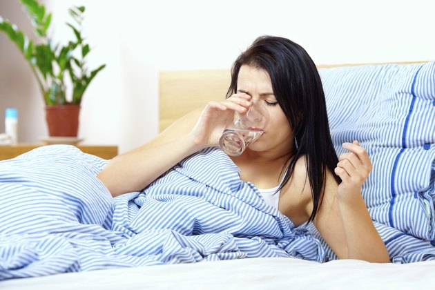 young woman feels thirsty in the morning