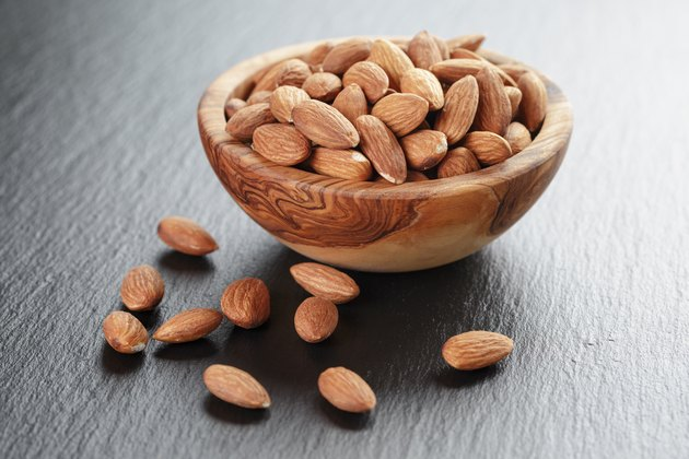 roasted almonds in bowl on slate background