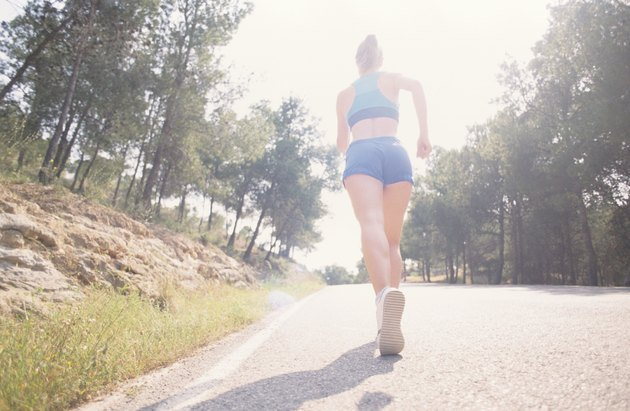 Jogger on road, High Key, Murcia, Spain, low angle view