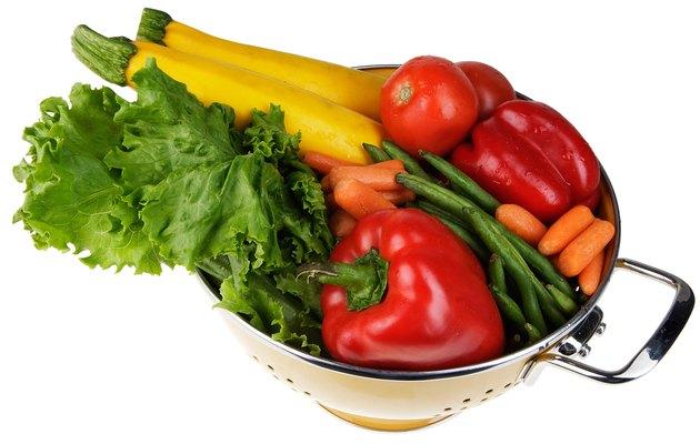Colander full of fresh vegetables