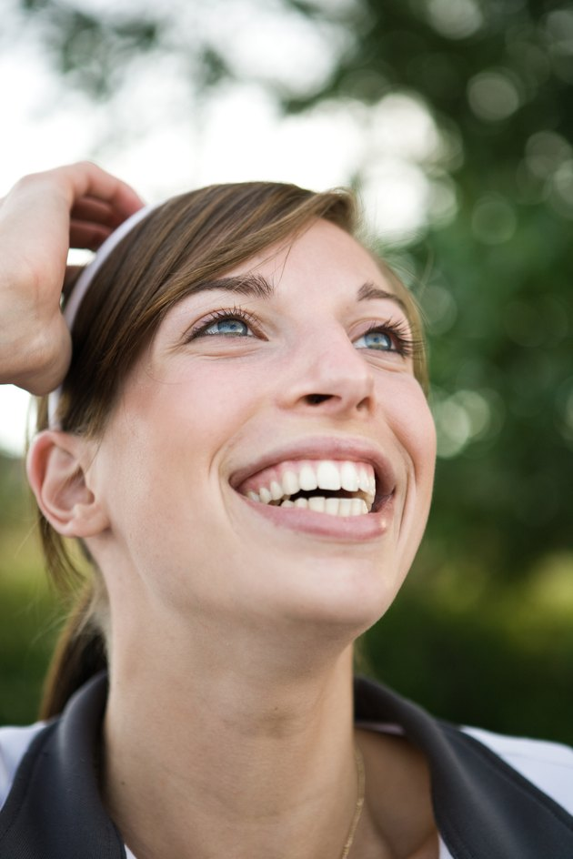 Outdoor head shot of smiling woman