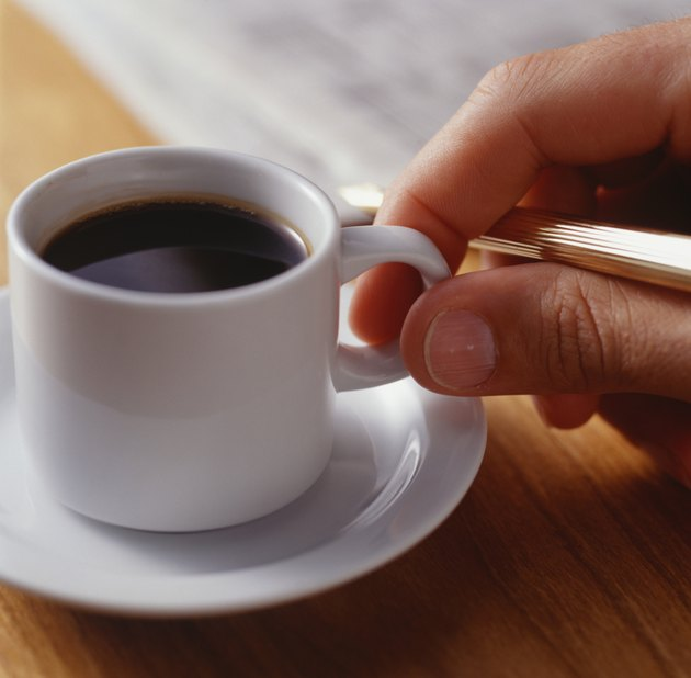 Man taking cup of espresso, Close-up of hand