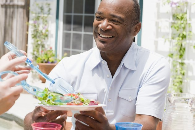 Smiling man with healthy salad