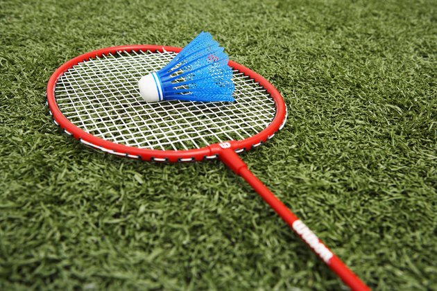 Badminton racket and shuttlecock on artificial turf