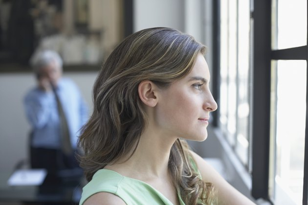Side profile of a businesswoman looking through a window