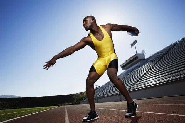 Athletic man preparing to throw discus