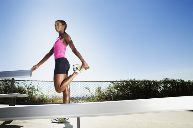 Athletic woman stretching