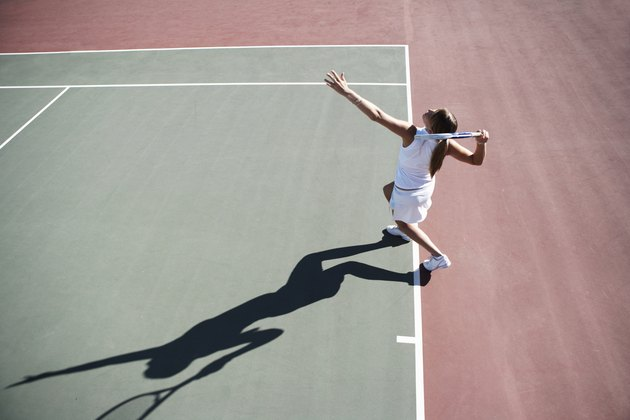Young woman playing tennis, elevated view