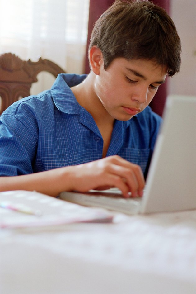 Young boy at work on laptop