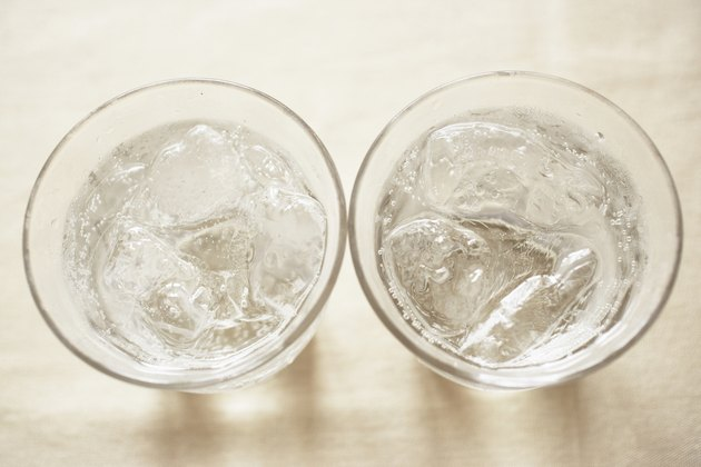 Glasses of soda on table, close up
