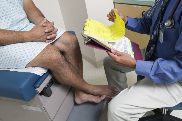 Male patient sitting on an examination table in a doctors office