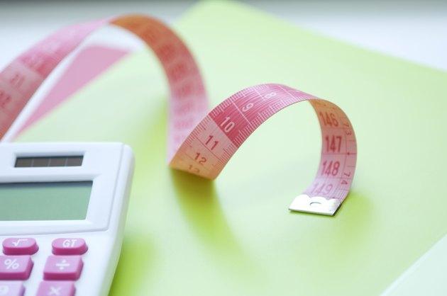 Calculator and tape measure on desk