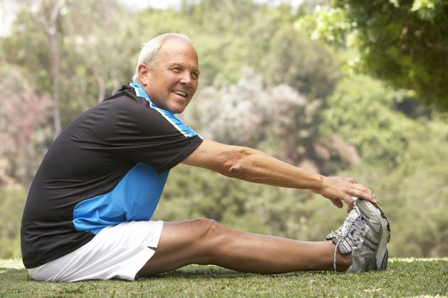 Senior Man Exercising In Park
