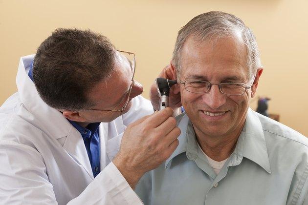 Audiologist doing an ear canal inspection