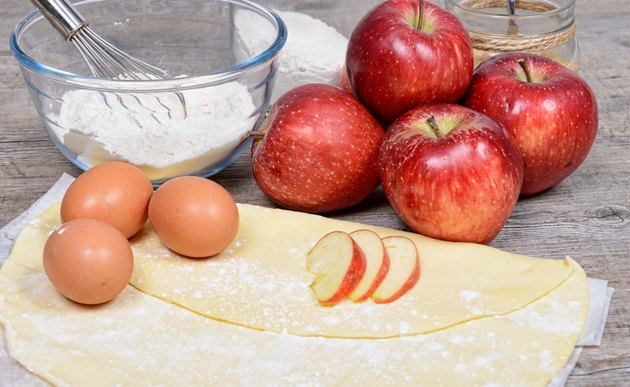 ingredients for apple pie, with flour, apples and ciders