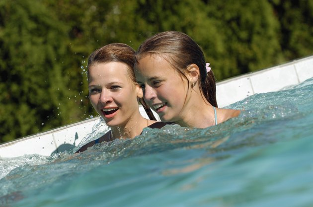 Two teenage girls in a swimming pool