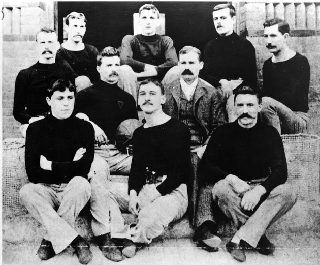 Portrait of Canadian physician and teacher Dr. James Naismith (1861 - 1939), inventor of the game of basketball, with his first basketball team, Springfield, Massachusetts, 1891.  Naismtih invented the game as an indoor wintertime diversion for the football players. (Photo by Hulton Archive/Getty Images)