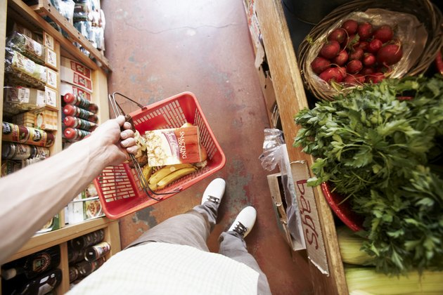 Man in organic food shop, personal perspective