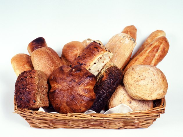 Variety of bread in basket, high angle view