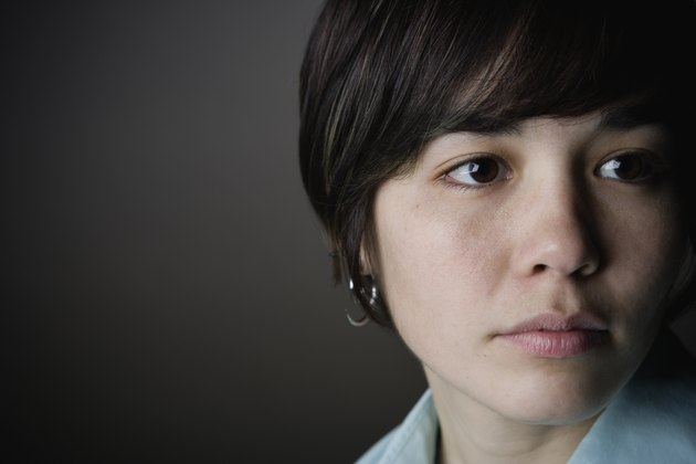 Close up of young woman looking to the side