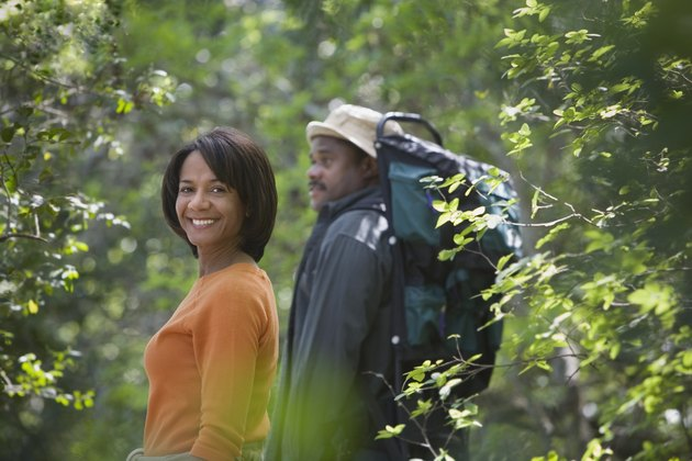 African couple hiking in woods