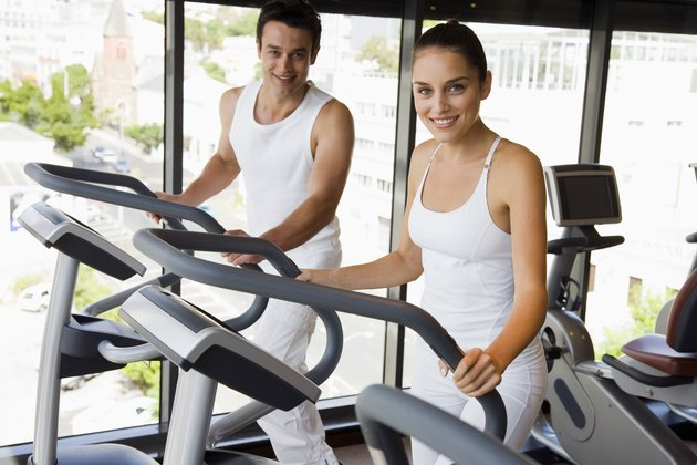 Couple using elliptical machines