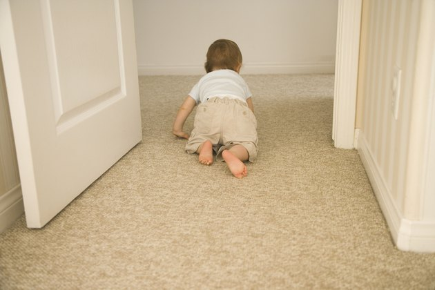 Baby crawling through doorway