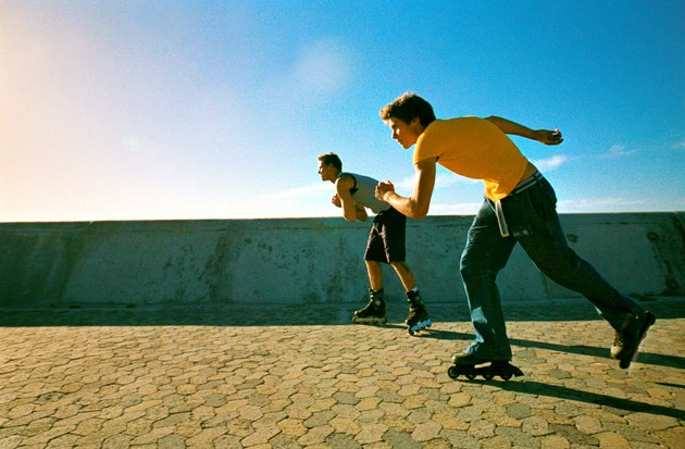 Two young men skating with in-line skates