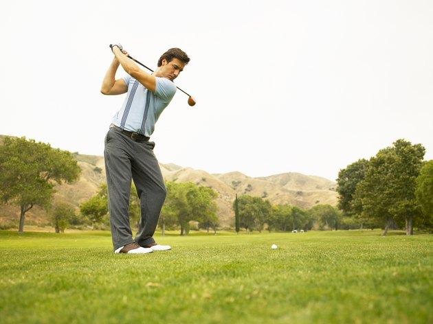 Golfer preparing to drive ball