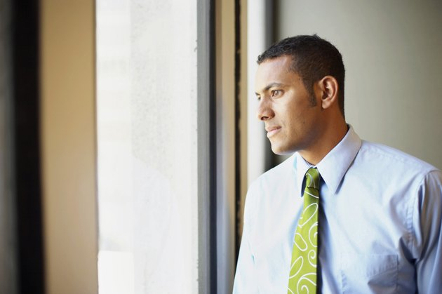 Businessman looking through window