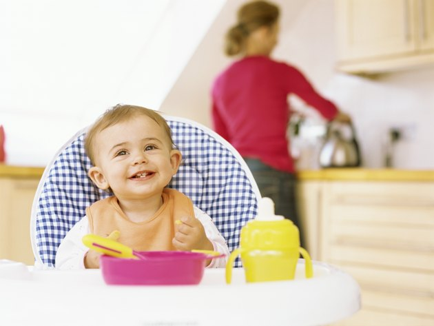 close-up of a baby girl sitting on a high chair