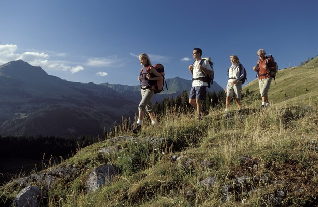 Men and women hiking on mountainside