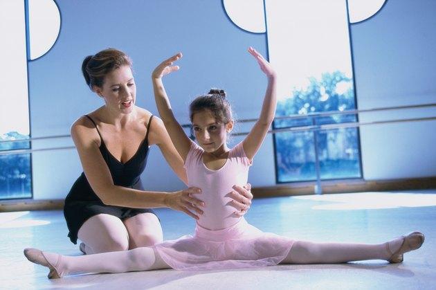 Ballet teacher training a girl