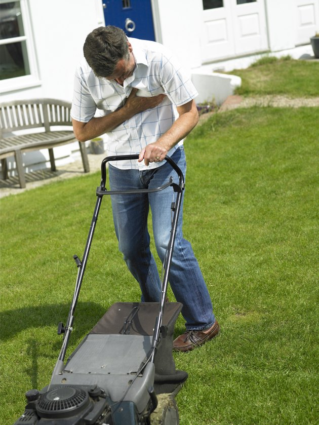 Man with chest pain mowing lawn