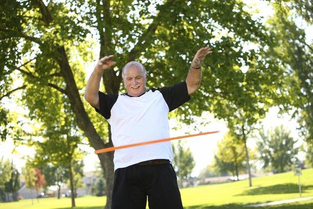 Senior man with hula hoop