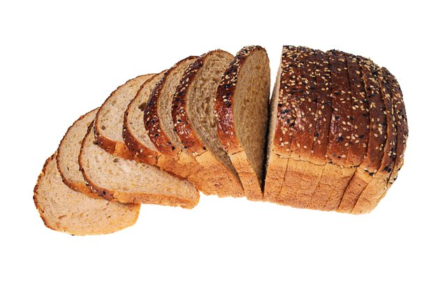 High angle still life of a sliced loaf of bread.
