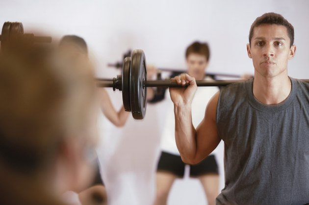 Man lifting weights in exercise class