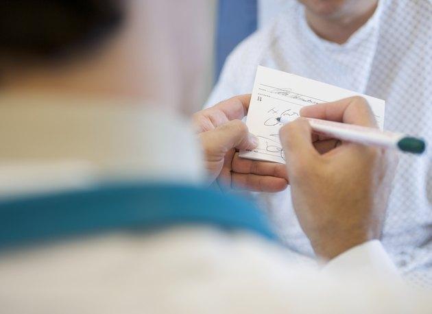 Doctor Filling Out Prescription