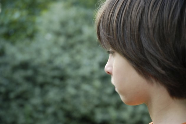 Profile of a dark haired boy
