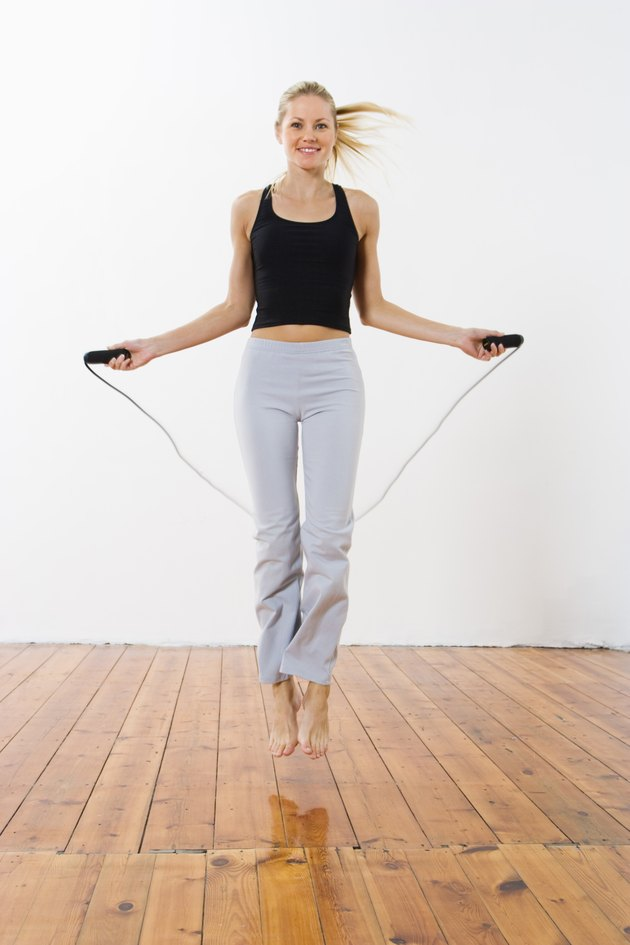 Smiling woman jumping rope
