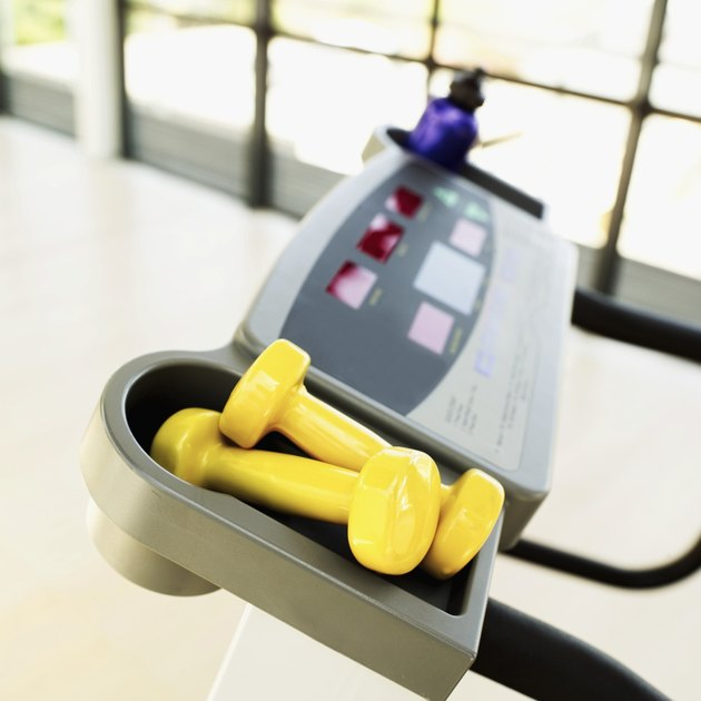Close-up of dumbbells lying on an exercise machine