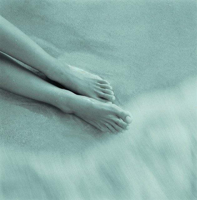 Womans Feet on Beach