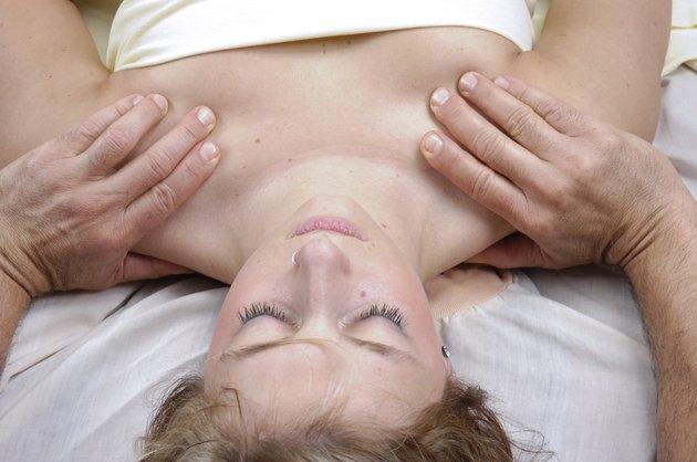 Woman having deep tisue shoulder massage
