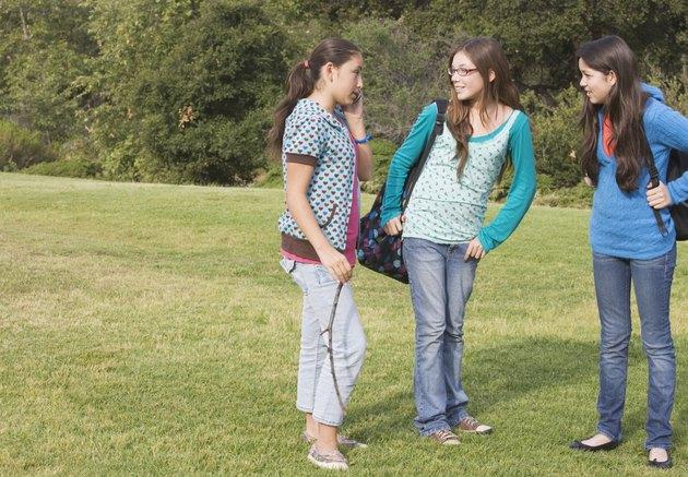 Hispanic teenaged girls in park
