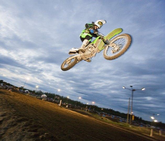 Motorcross rider jumping on track