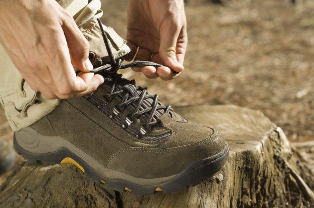 Hands tying shoe