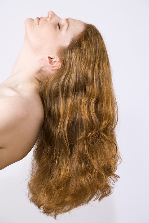 Woman with bare shoulders in profile